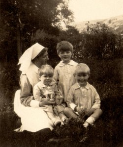 John, Michael and Bill Holdsworth with nurse, 1923