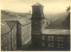 The Clock Tower and weaving sheds at Shaw Lodge Mills, Halifax, 1933
