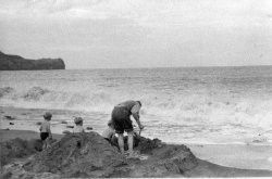 David, Howard, Michael and Bill Holdsworth, Building a sand-castle at Sandsend, Sept 1954
