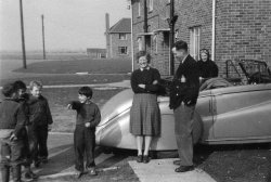Aileen, Johnny, Sarah, and Peter Woodward, and the Bentley BCP555. 1956