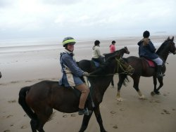 Riding on the beach  at Bream Sands, Somerset